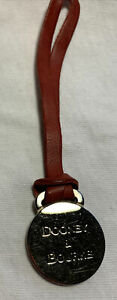Dooney & Bourke Embossed Silver Medallion On Red Leather Cord Bag Charm