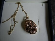 gold 2 coloured locket with chain for 2 photographs