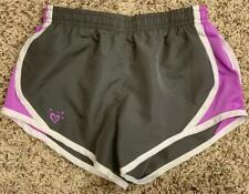 """""""A*"""" JUSTICE Youth medium dry fit gray and purple shorts"""