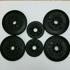 Four 10, Two 2 1/2 Pound BFCO Black Cast Iron Weight Plates. 45 Pounds Total.