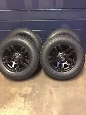 """18"""" Fuel Pump Black Wheels 33"""" Toyo AT2 Wheel and Tires Package Chevy GMC 6x5.5"""
