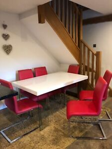 Stunning white gloss dining table with 6 red chairs