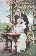 Romance Postcard - Young Man Stood Behind and Young Lady Sat at Table  XX676