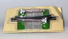 HO passage à niveau avec 2 rails supplémentaires
