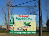 OLD STYLE MOUNTAIN DEW HILLBILLY DI-CUT SODA COLA STEEL 2 SIDE SIGN MADE IN USA!