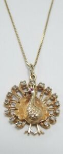 10 K solid Gold Peacock With Diamonds And Sapphire  6.5 grams necklace + pendant