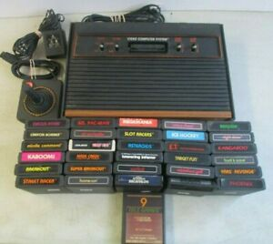 ATARI 2600 WOOD GRAIN CONSOLE WITH 31 GAMES AND 1 CONTROLLER TESTED WORKING
