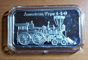 ONE .999 ONE OUNCE SILVER BAR(AMERICAN TYPE 4.4.0 STEAM ENGINE) IN ACRYLIC CAP.