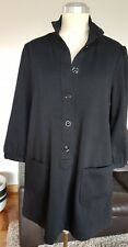 Ladies Witchery swing top size Medium. Black ponte fabric, button front opening.