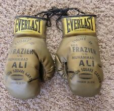 Joe Frazier vs Muhammad Ali MSG Souvenir Gold Boxing Gloves Set January 28, 1974