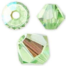 Swarovski Crystal Bicone.Peridot AB Color. 6mm. Approx. 48 PCS. 5328