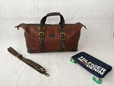 Tommy Hilfiger Brown Leather Holdall. Brass Buckles, Shoulder Strap. Dust bag