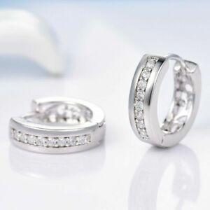 18K White Gold and Diamond White Crystal Hoop Earrings        399