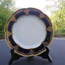 assiette ancienne en porcelaine de sèvres bleu et riche décor a l or signée