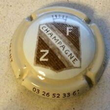 Capsule de champagne Zimmerlin Flamant (13. contour crème)