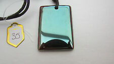 A BEAUTIFUL OBLONG TITANIUM AGATE PENDANT ON A WAXED CORD NECKLACE.  (35)