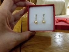 Brand new tiny silver tone earrings with small pearl beads and gift box