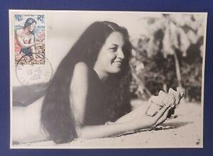 Maximum card French Polynesia -Tahiti . Local lady on sand beach.