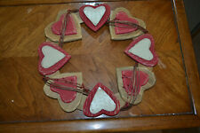 Multi-layer wood and metal Valentine's Day wreath.