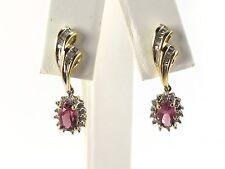 14k Yellow Gold Diamond And Pink Topaz Dangling Earrings