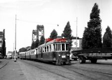 PHOTO  NETHERLANDS TRAMS 1959 ROTTERDAM ROSESTRAAT RTM M TRAM NO 1802 AND TRAIN