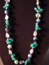J480 ENCHANCED BANDED GREEN AGATE & GREEN GLASS NECKLACE APROX 32 IN TGW 15.00CT