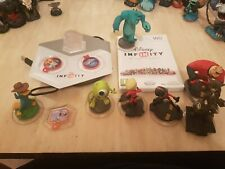 Disney Infinity Starter Pack Wii *PERFECT CONDITION* plus exta figures and disc