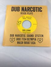 Dub Narcotic Sound System - Shake-A-Puddin' - K Records - DBN 107 Beat Happening