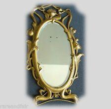 Art noveau cast metal mirror with floral designs
