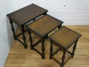 DARK OAK NEST OF 3 TABLES, UPPER SURFACES are VENEERED, With Turned Supports.
