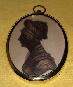 Oval Portrait Miniature in silhouette of a lady in elaborate head gear
