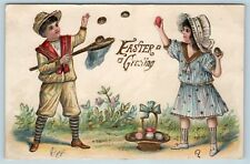 Postcard Easter Greeting Girl Tossing Eggs Boy Catching in Net Gold Gilt 1909 O2