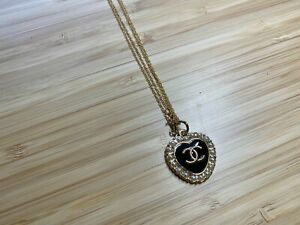 Authentic vintage Chanel logo heart pendant faux pearl gold and black necklace