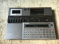 Sharp PC-1251 computer  + Sharp CE-125 microcassette and printer base unit
