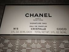 Chanel No. 5, Cristalle and Coco Parfum with Signature Bag. 1FL. OZ .30 ML. EACH