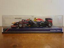 Minichamps 4012138123458 Red Bull RB9 - Sebastian Vettel Brazil GP Winner 2013