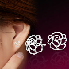Silver tone cutout rose flower stud earrings