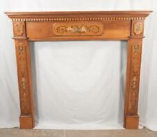 Satinwood fireplace surround having straight cornice with dental moul. Lot 378