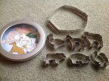 set of metal barnyard animal cutters in a tin