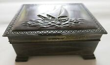 An Art Deco metal box with sailing boat lid