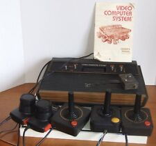 Atari 2600 4 Switch Wood Grain Model, 3 Joysticks, 2 Paddles, 18 Games & Manuals