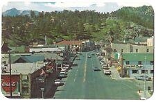 1968 Estes Park Colorado chrome postcard ELKHORN Ave main street cars Coca Cola
