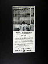 1957 Hopkins Airport Flight Information Board photo GE Glow Lamps print Ad
