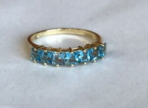 14k Yelllow Gold Ring With Genuine Blue Topaz ring Size 7 - 2.2grams