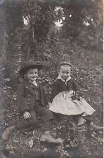 BABES IN THE WOODS: PORTRAIT OF YOUNG BOY AND GIRL IN THE FOREST (1910 RPPC)