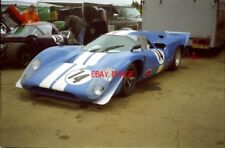 PHOTO  GEOFF HARRIS' LOLA T70 MK3B-CHEVROLET IN THE PADDOCK AREA RESERVED FOR TH