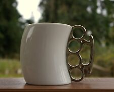 Brass Knuckles Shaped White Ceramic Coffee Mug 2009 Knockout by Fred & Friends