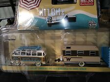Green light VW Samba bus in 1964 Winnebago 216 travel trailer with canopy nib