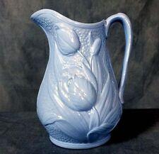 Rare 19th. Century Staffordshire jug with relief Tulip motif.