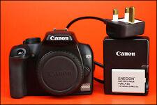 Canon EOS 1000D DSLR Cuerpo de Cámara + Cargador de batería y Canon Genérico